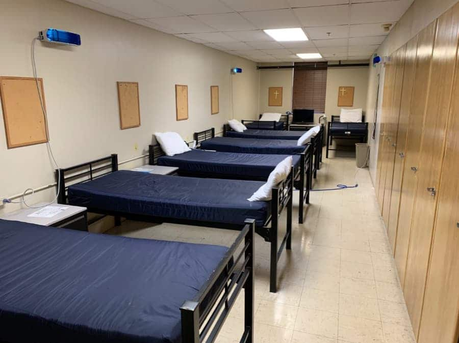 Homeless shelter living space with multiple germicidal ultraviolet (GUV) light fixtures